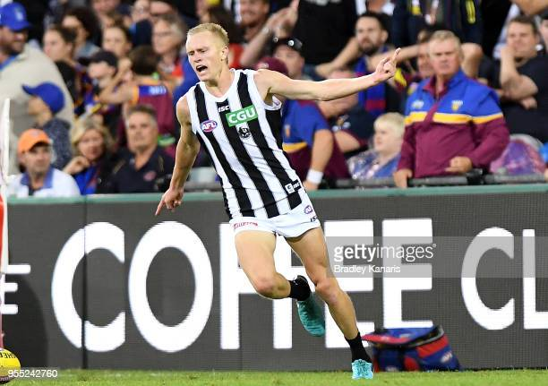 Jaidyn Stephenson of Collingwood celebrates kicking a goal during the round seven AFL match between the Brisbane Lions and the Collingwood Magpies at...