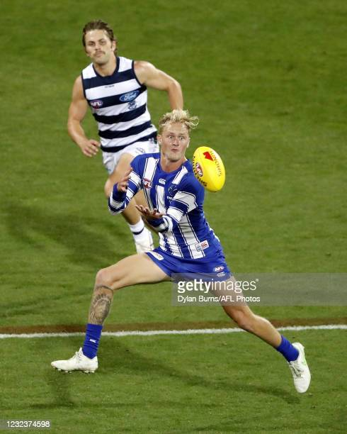 Jaidyn Stephenson of the Kangaroos marks the ball during the 2021 AFL Round 05 match between the Geelong Cats and the North Melbourne Kangaroos at...