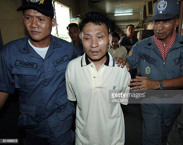 Jail guards escort Muklis Yunos , Muslim extremist allegedly linked to Moro Islamic Liberation Front to a Manila court, 29 March 2005, for a trial....