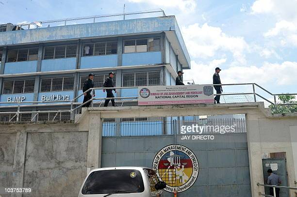 Jail guards patrol atop the high walls of the Bureau of Jail Management and Penology prison in southern Manila September 1 2010 where members of an...