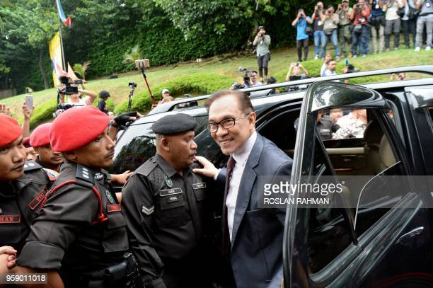 Jailed former opposition leader and current federal opposition leader Anwar Ibrahim arrives at his house following his release from hospital in Kuala...