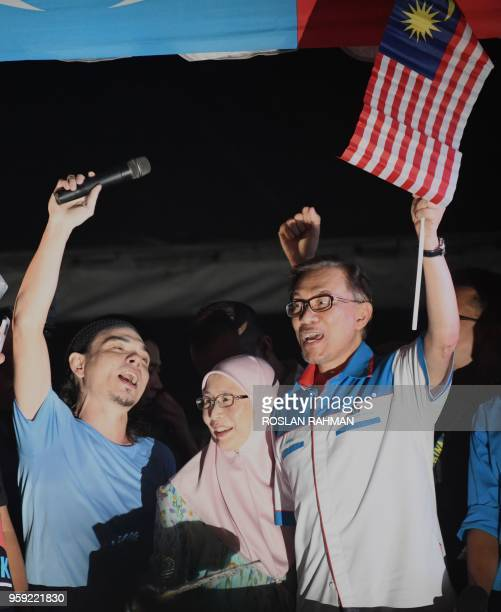 Jailed former opposition leader and current federal opposition leader Anwar Ibrahim with his wife Wan Azizah greet supporters during a rally in Kuala...