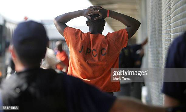 Jailed inmate walks in a temporary prison inside a Greyhound bus terminal September 6, 2005 in New Orleans, Louisiana. About 150 inmates who were...