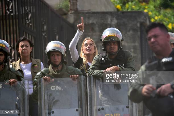 TOPSHOT Jailed opposition leader Leopoldo Lopez's wife Lilian Tintori and mother Antonieta Mendoza de Lopez are stopped by the National Guard 500...