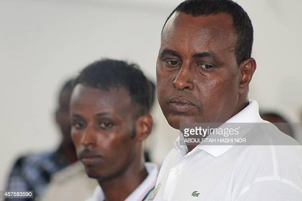 Jailed Somali journalists Abdimalik Mahmud owner of Radio Shabelle in Mogadishu and Ahmed Abdi Hassan stand at the Banadir court in Mogadishu on...