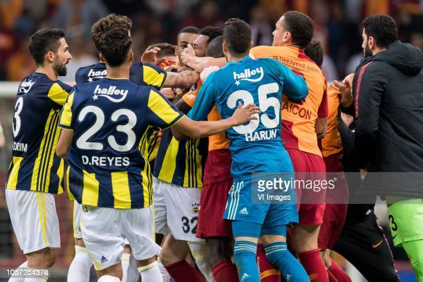 Jailson Marques Siqueira of Fenerbahce SK is attacked by Maicon Pereira Roque of Galatasaray SK during the Turkish Spor Toto Super Lig football match...