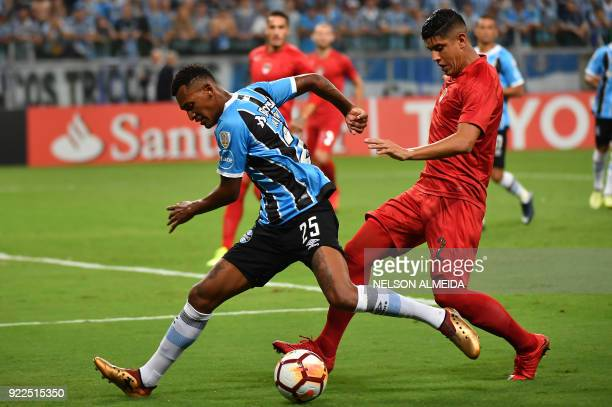 Jailson of Brazils Gremio vies for the ball with Alan Franco of Argentina's Independiente during their Recopa Sudamericana 2018 second leg final...