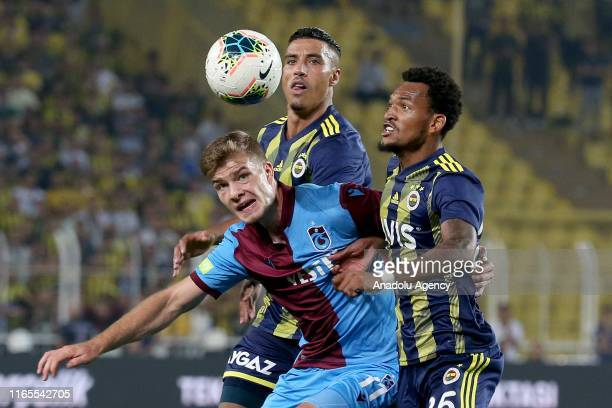 Jailson of Fenerbahce in action against Alexander Sorloth of Trabzonspor during Turkish Super Lig week 3 match between Fenerbahce and Trabzonspor at...