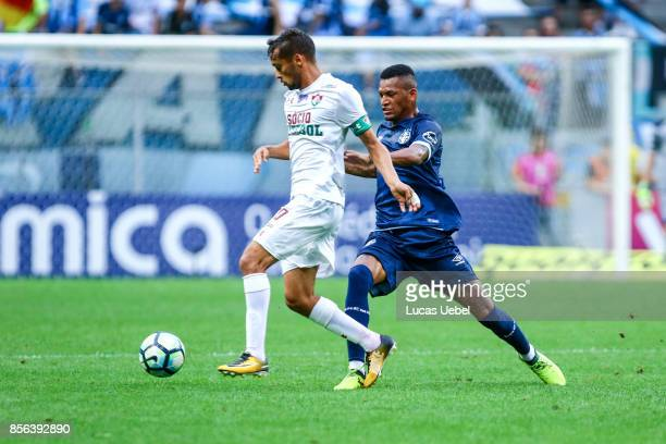 Jailson of Gremio battles for the ball against Gustavo Scarpa of Fluminense during the match Gremio v Fluminense as part of Brasileirao Series A 2017...