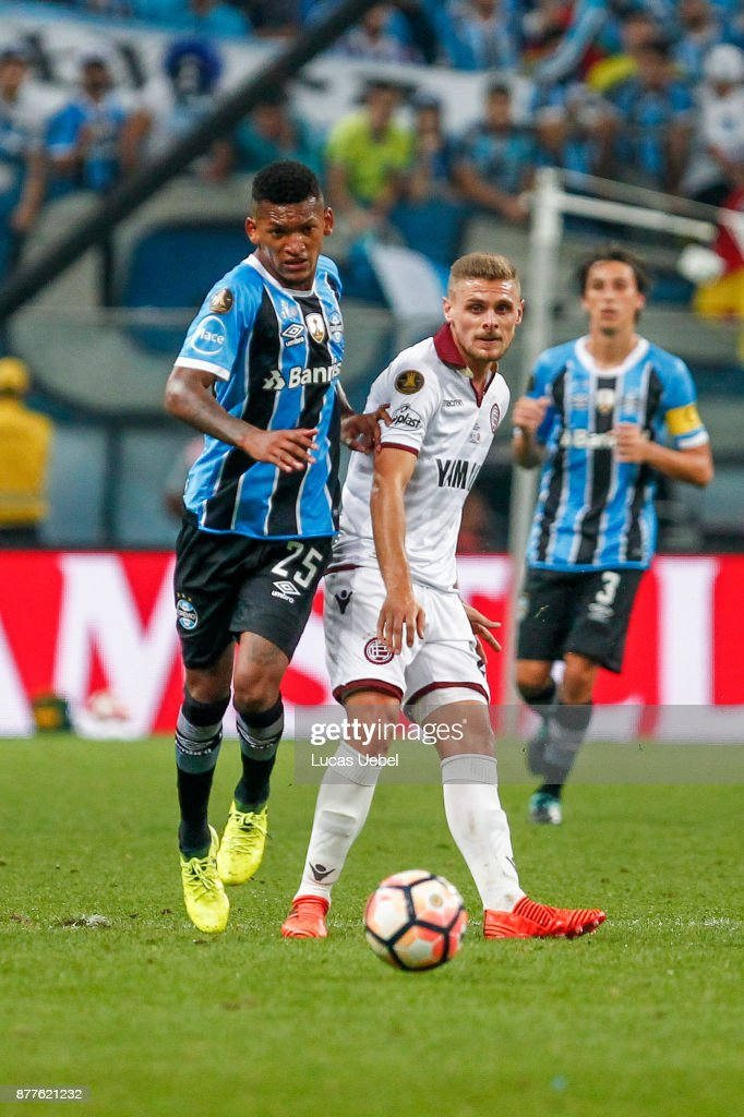 NOVEMBER 22 - Jailson of Gremio battles for the ball against Ivan Marcone of Lanus during the match between Gremio and Lanus, part of Copa Bridgestone Libertadores 2017 Final, at Arena do Gremio on November 22, 2017, in Porto Alegre, Brazil.