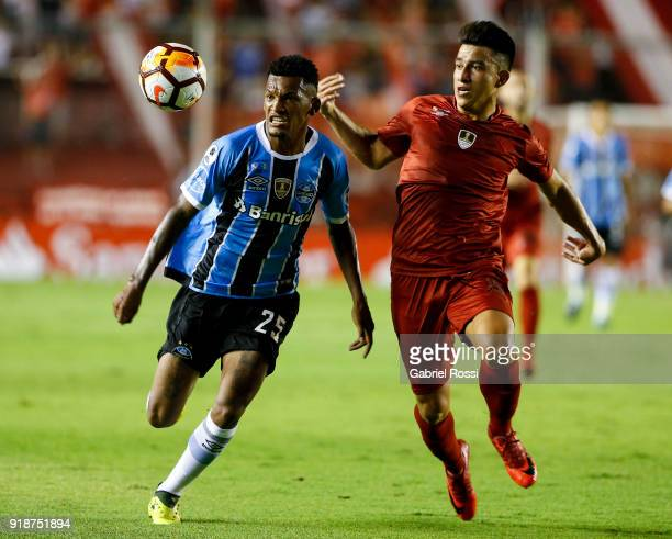 Jailson of Gremio fights for the ball with Fernando Gaibor of Independiente during the first leg match between Independiente and Gremio as part of...