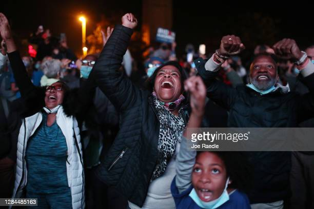 Jailyn Banks and King M and others celebrate as President-elect Joe Biden arrives on stage at the Chase Center to address the nation on November 07,...