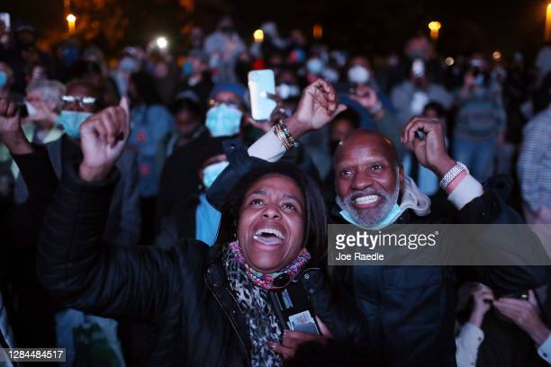 Jailyn Banks and King M celebrate as President-elect Joe Biden arrives on stage at the Chase Center to address the nation on November 07, 2020 in...