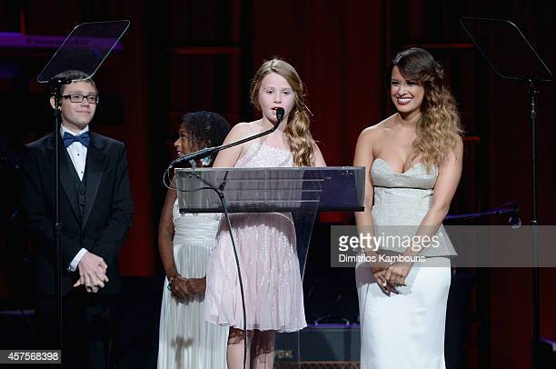 Jaiman Jozlyn and Arabelle of Children's National Health System speak onstage during Angel Ball 2014 hosted by Gabrielle's Angel Foundation at...