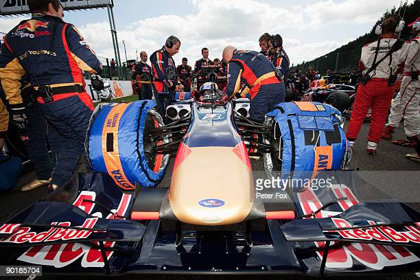 Jaime Alguersuari of Spain and Scuderia Toro Rosso prepares on the grid before driving during the Belgian Grand Prix at the Circuit of Spa...