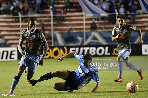Jaime Arrascaita of Bolivia's Bolivar vies for the ball with Marcos Acuña of Argentina Racing Club during their 2016 Copa Libertadores football match...