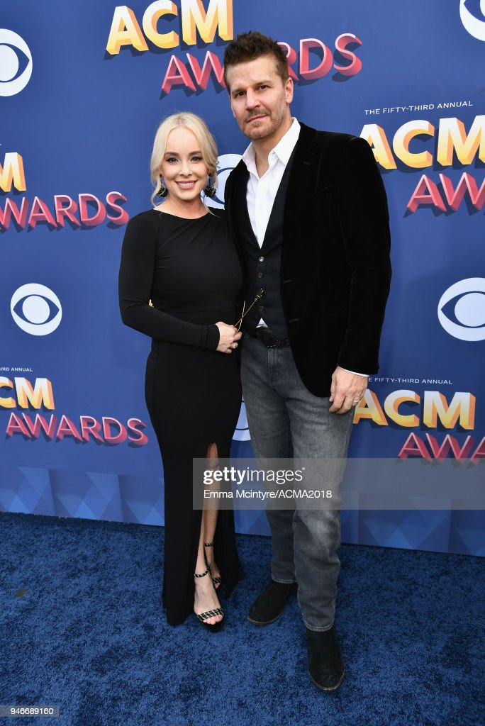 Jaime Bergman (L) and David Boreanaz attend the 53rd Academy of Country Music Awards at MGM Grand Garden Arena on April 15, 2018 in Las Vegas, Nevada.