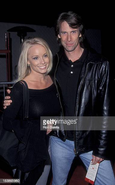 Jaime Bergman and Michael Bay attend the premiere of EDtv on March 16 1999 at the Universal Ampitheater in Universal City California