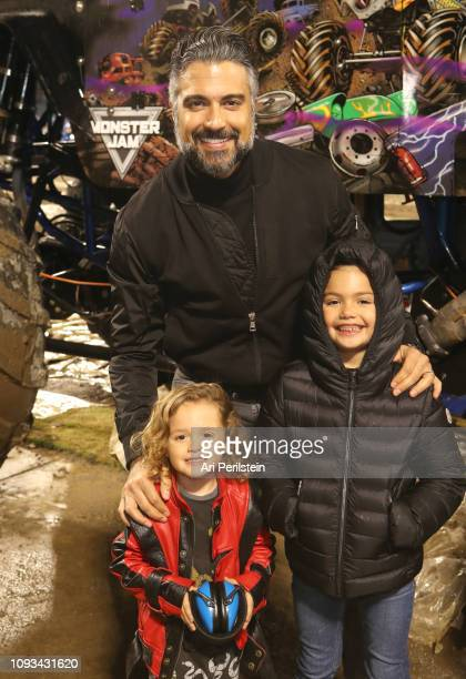 Jaime Camil Elena Camil and Jaime Camil III attend the Monster Jam Celebrity Event at Angel Stadium on January 12 2019 in Anaheim California
