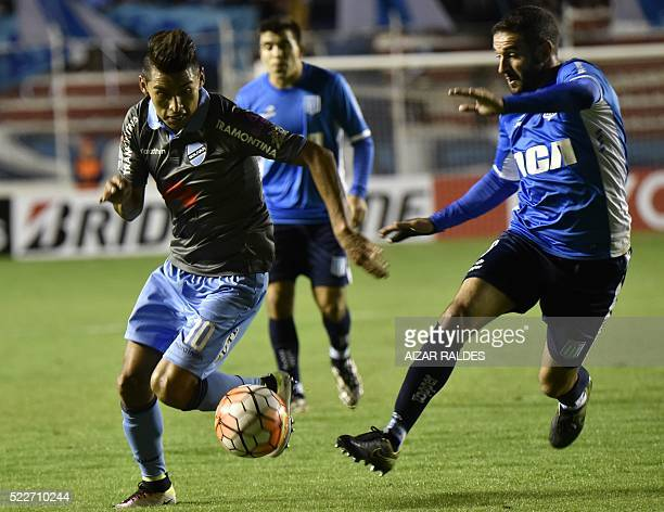 Jaime Cardoso of Bolivia's Bolivar vies for the ball with Marcos Acuña of Argentina Racing Club during their 2016 Copa Libertadores football match...