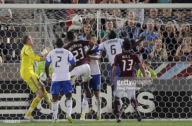 Jaime Castrillon of the Colorado Rapids heads the ball past Jeb Brovsky, Hassoun Camara and goalkeeper Greg Sutton of the Montreal Impact for the...