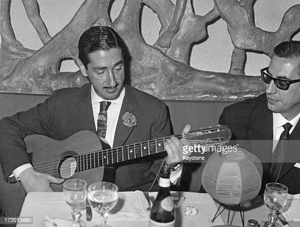Jaime de Mora y Aragon , brother of Queen Fabiola of Belgium, plays the guitar for his friends at a restaurant in Rome, 11th February 1961.