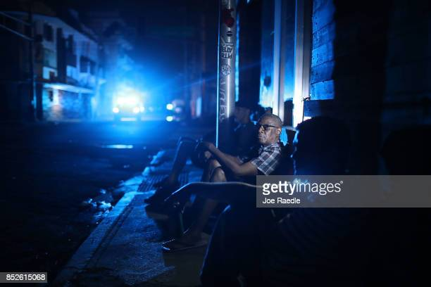 Jaime Degraff sits outside as he tries to stay cool as people wait for the damaged electrical grid to be fixed after Hurricane Maria passed through...