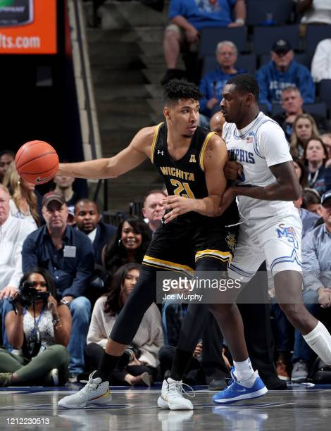 Jaime Echenique of the Wichita State Shockers dribbles against Lance Thomas of the Memphis Tigers during a game on March 5 2020 at FedExForum in...