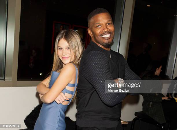 Jaime Foxx and Harlow Rocca pose for portrait at A Dark Foe Film Premiere on February 15 2020 in Los Angeles California