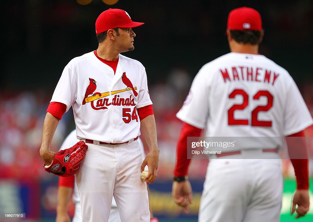 Jaime Garcia #54 of the St. Louis Cardinals is pulled from the game by manager Mike Matheny #22 during the game against the Cincinnati Reds during Opening Day on April 8, 2013 at Busch Stadium in St. Louis, Missouri.