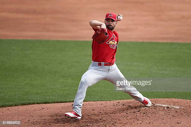 Jaime Garcia of the St Louis Cardinals throws a pitch during the first inning of a spring training game against the Atlanta Braves at Champion...