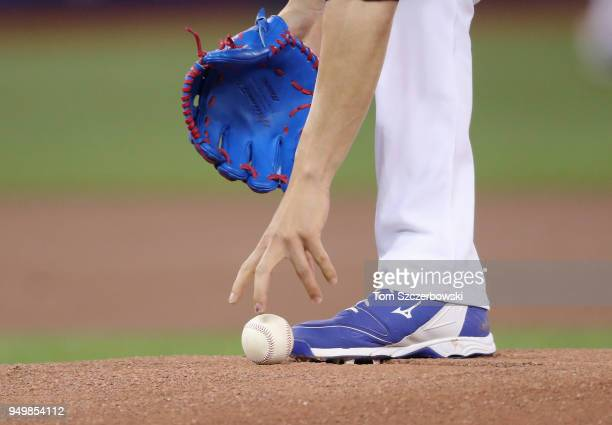 Jaime Garcia of the Toronto Blue Jays picks up the baseball off the mound as he gets ready to pitch the first inning during MLB game action against...