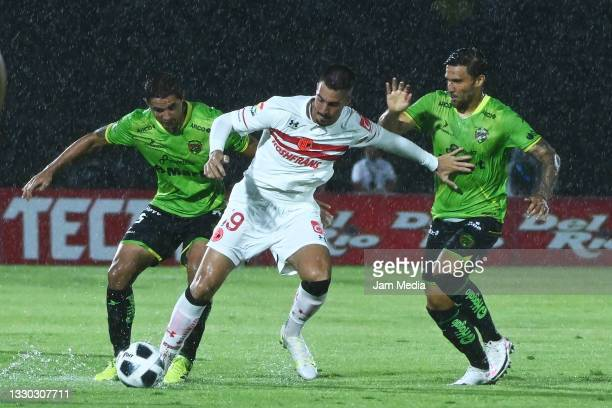 Jaime Gomez and Andres Iniestra of Juarez fight for the ball with Ian Gonzalez of Toluca during the 1st round match between FC Juarez and Toluca as...