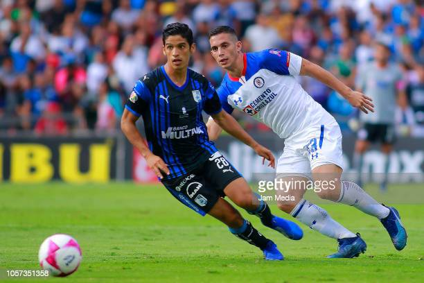 Jaime Gomez of Queretaro fights for the ball with Angel Mena of Cruz Azul during the 13th round match between Queretaro and Cruz Azul as part of the...