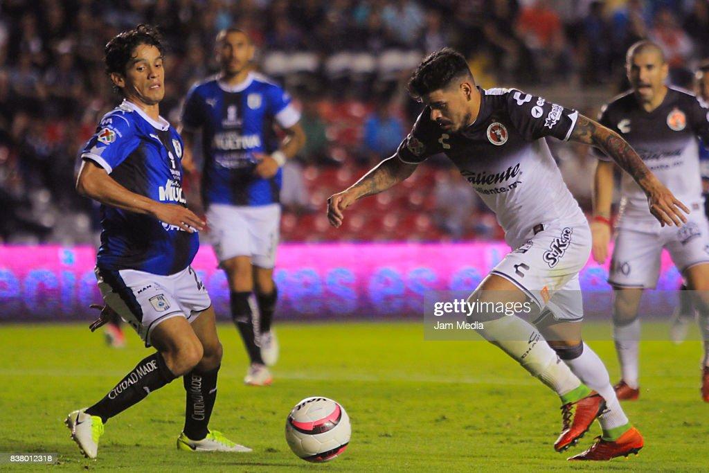 Jaime Gomez of Queretaro fights for the ball with Gustavo Bou of Tijuana during the sixth round match between Queretaro and Tijuana as part of the Torneo Apertura 2017 Liga MX at La Corregidora Stadium on August 22, 2017 in Queretaro, Mexico.