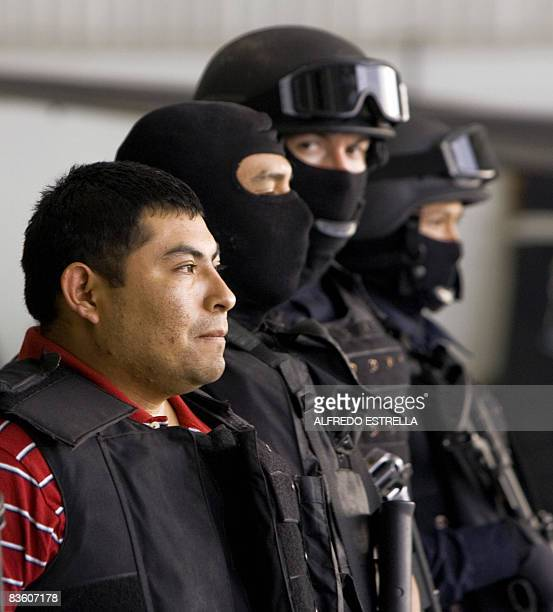Jaime Gonzalez Duran aka Hummer founder of a group of hitmen called the Zetas is shown to the press at the hangar of the Federal Police in Mexico...