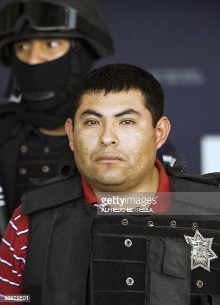 "Jaime Gonzalez Duran, a.k.a. ""Hummer"", founder of a group of hitmen called the ""Zetas"", is shown to the press at the hangar of the Federal Police in..."