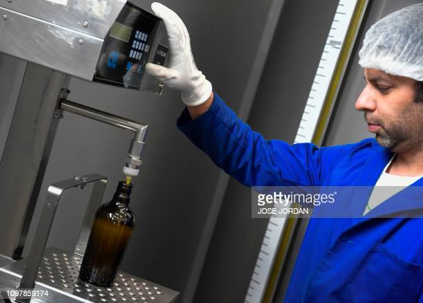 Jaime Grimaldo bottles olive oil at a factory in Oliete northeastern Spain on December 17 2018 Residents began moving away from rural towns and...
