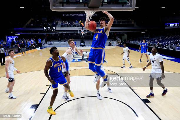 Jaime Jaquez Jr. #4 of the UCLA Bruins dunks the ball against the Brigham Young Cougars in the first round game of the 2021 NCAA Men's Basketball...