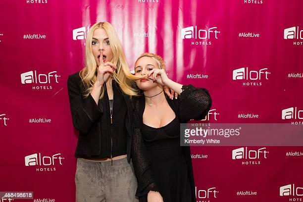 Jaime King and Bea Miller pose for a photograph ahead of a Miller performance at the Aloft Hotel 100 Days of Music on November 5 2014 in Millbrae...