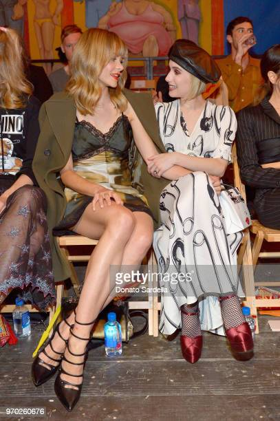 Jaime King and Emma Roberts attend the Moschino Spring/Summer 19 Menswear and Women's Resort Collection at Los Angeles Equestrian Center on June 8...