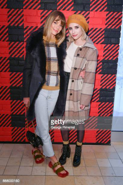Jaime King and Emma Roberts attend Woolrich Yorkdale Grand Opening at Yorkdale Shopping Center on December 7 2017 in Toronto Canada