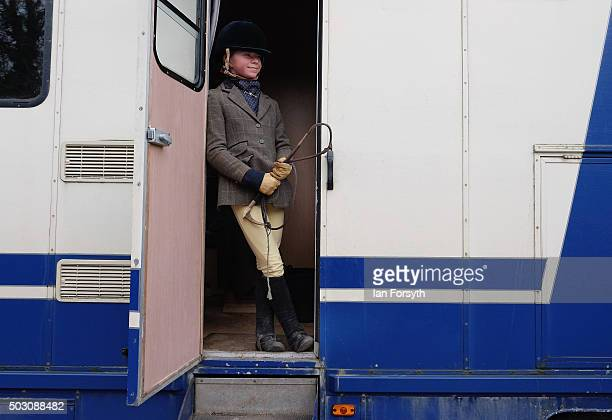 Jaime Latham from Middlesbrough stands in the door of a horsebox as horses, riders and hounds from the Cleveland Hunt prepare to ride out on the...