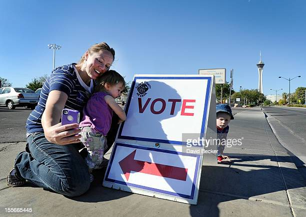 Jaime Lea photographs herself and her children oneyear old Scarlett and Zackary after casting her ballot at John Fremont Middle School on November 6...