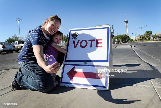 Jaime Lea photographs herself and her one yearold daughter Scarlett after casting her ballot at John Fremont Middle School on November 6 2012 in Las...