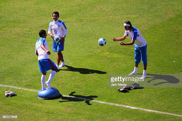 Jaime Lozano, Israel Lopez and Gerardo Lugo in action during a training session at the Azul Stadium on January 28, 2010 in Mexico City, Mexico.