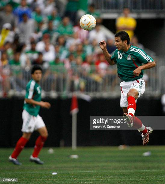 Jaime Lozano of Mexico passes the ball with his head against Costa Rica during their quarterfinal match of the CONCACAF Gold Cup 2007 tournament on...
