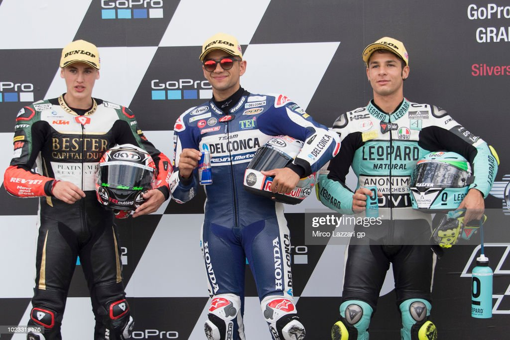 Jaime Masia of Spain and Bester Capital Dubai, Jorge Martin of Spain and Del Conca Gresini Moto3 and Lorenzo Dalla Porta of Italy and Leopard Racing celebrate at the end of the qualfying practice during the MotoGp Of Great Britain - Qualifying at Silverstone Circuit on August 25, 2018 in Northampton, England.
