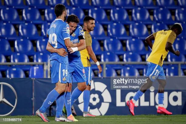 Jaime Mata of Getafe celebrates 2-1 with Jorge Molina of Getafe during the La Liga Santander match between Getafe v Real Sociedad at the Coliseum...