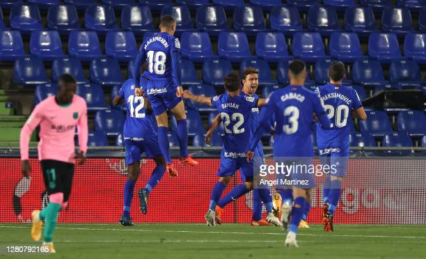 Jaime Mata of Getafe celebrates with his team mates after scoring his team's first goal during the La Liga Santader match between Getafe CF and FC...